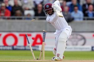 West Indies Shai Hope is bowled by England's Toby Roland-Jones.
