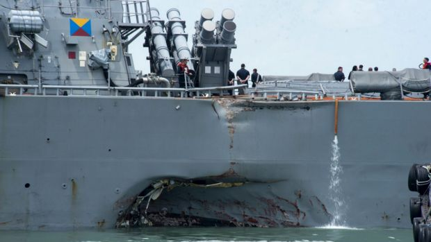 Damage to the portside of the USS John S. McCain is visible.