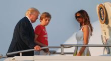 President Donald Trump, first lady Melania Trump and son Barron Trump board Air Force One at Morristown Municipal ...