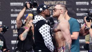 In this July 13, 2017, file photo, Floyd Mayweather Jr., left, and Conor McGregor, of Ireland, face each other for ...