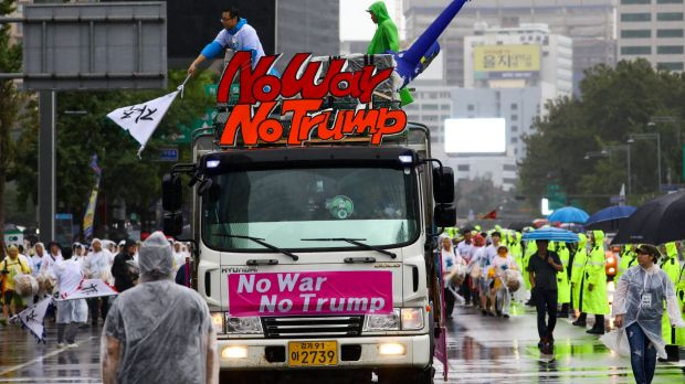A truck carries a placard reading 'No War No Trump' following a rally against the deployment of the Terminal ...