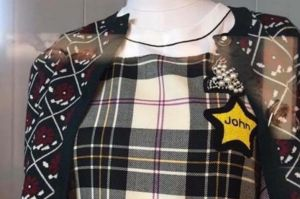 An image of a Miu Miu dress that was pulled from sale after complaints it resembled a yellow star worn by Jews in Nazi ...