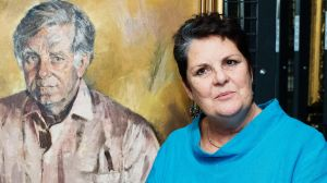 Daughter Melanie Bryan with the Judy Cassab portrait of her father, Morris West.