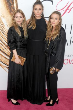 Elizabeth Olsen (centre) with her twin sisters Ashley (left) and Mary-Kate Olsen in 2016.