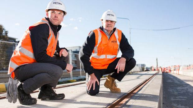 The test track slabs for the light rail have been laid. From left, Mark Jones deputy project director, and Glenn ...