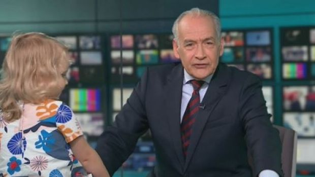 British ITV newsreader Alastair Stewart is upstaged by toddler Iris Wronka during a live TV interview