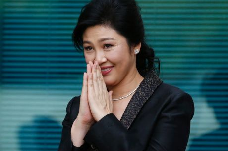 Yingluck Shinawatra thanks supporters as she arrives at the Supreme Court for her final statements on August 1.