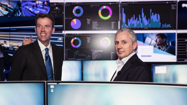 Dan Tehan, Minister Assisting the Prime Minister for Cyber Security and Telstra chief executive Andrew Penn at the ...