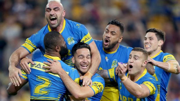 Statement win: Parramatta players celebrate a try.