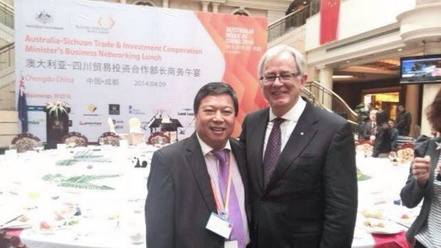 Mr Junus pictured with former trade minister Andrew Robb at a government-run networking event for Chinese businessmen.
