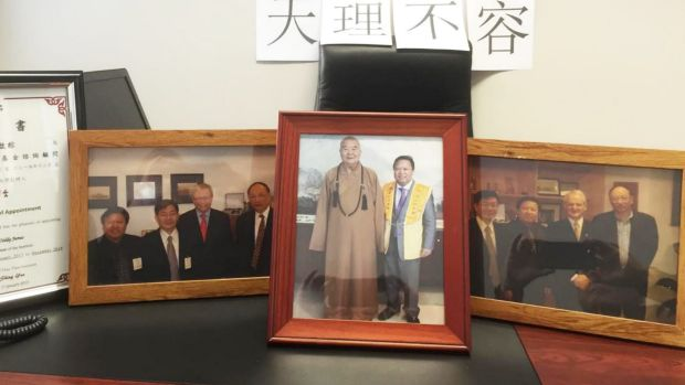 Mr Junus' now-abandoned Pitt Street Office was adorned with photos of him with Kevin Rudd, Phillip Ruddock and the ...
