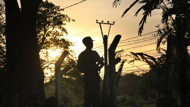A border patrol guard at a police post in Kyee Kan Pyin, Buthidaung, in the Rakhine state of Myanmar.
