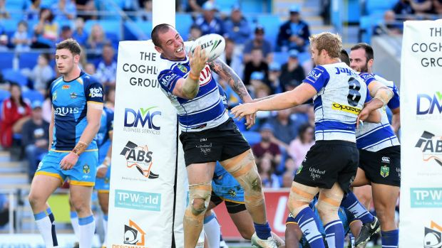 Consolation victory: David Klemmer celebrates after scoring against the Titans.