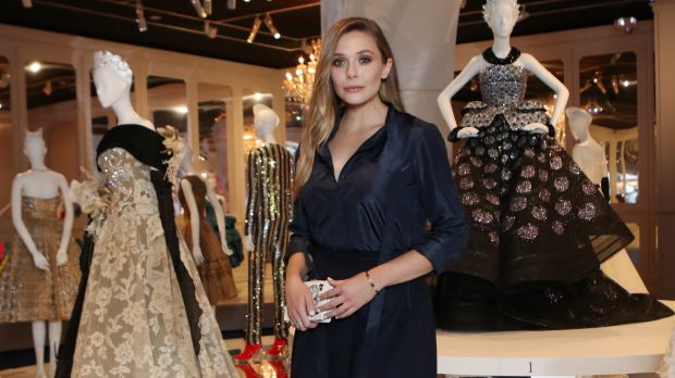 Actress Elizabeth Olsen poses inside the Dior exhibition ahead of Saturday night's gala.