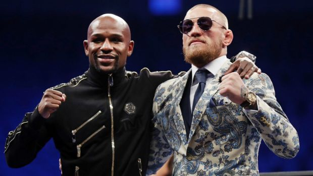 Floyd Mayweather jnr and Conor McGregor after the fight.