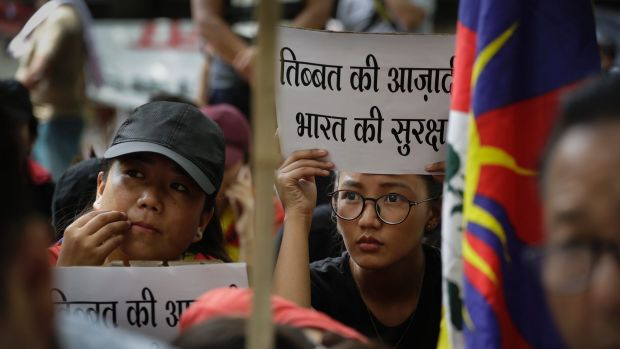 Exile Tibetans in New Delhi join a protest to show support for India in Doklam stand-off.