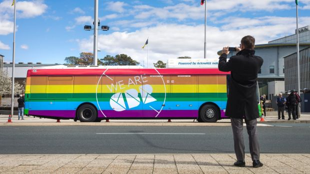 Greens leader Shane Rattenbury takes a snap of Canberra's new rainbow bus in August.