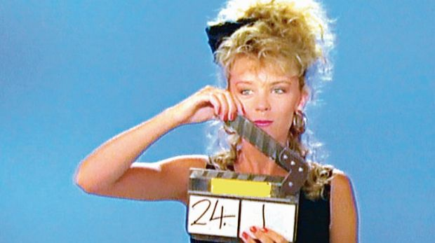 """Kylie Minogue filming the music video for her first single """"Locomotion"""", 1987."""