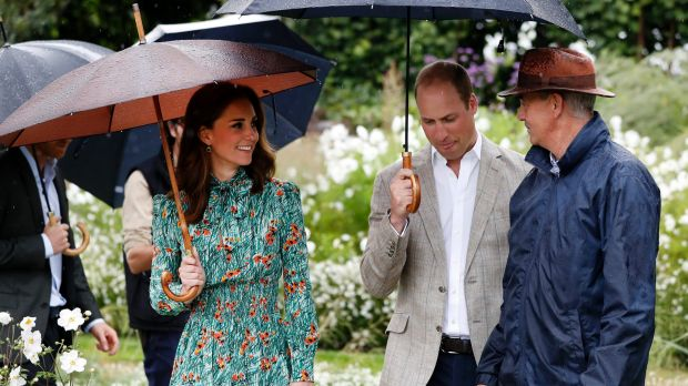 William and his wife Kate, Duchess of Cambridge are given a tour at the memorial garden in Kensington Palace.