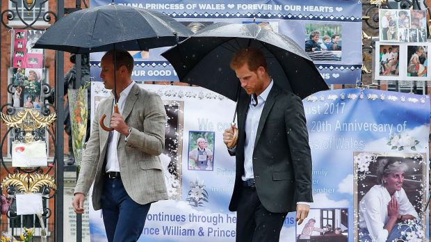 Britain's Prince William, left, and Prince Harry observed the tributes on Wednesday.