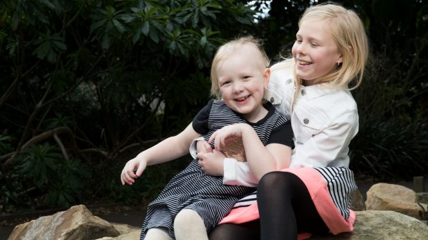 For the past four years, Evie, left has been taking powerful drugs and undergoing neurosurgery and chemotherapy to beat ...