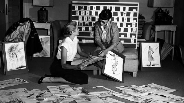 Grace Kelly and Edith Head look over sketches for To Catch a Thief (1955).