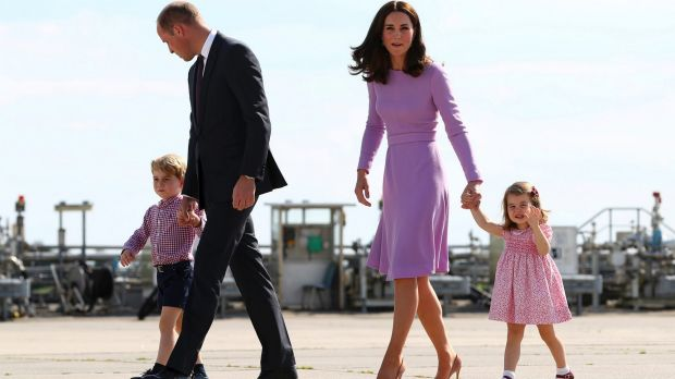 Prince William, and his wife Kate, the Duchess of Cambridge, second right, and their children, Prince George, left, and ...