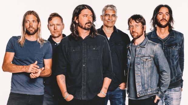 Dave Grohl (centre) will bring the Foo Fighters to Australia in January as part of their world tour.