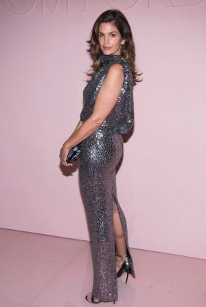 Cindy Crawford attends the Tom Ford show as part of NYFW Spring/Summer 2018 in a glittery. slinky gown.