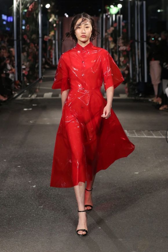 Friday: If there is one item that is a must-buy for spring, it's a red trench coat, as shown by French brand Lacoste, ...