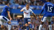 Tottenham Hotspur's Harry Kane, centre, shoots a shot towards goal during the English Premier League soccer match ...