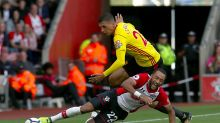 Southampton's Nathan Redmond and Watford's Jose Holebas, top, battle for the ball during the English Premier League ...