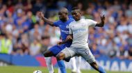 Chelsea's N'Golo Kante, left, vies for the ball with Everton's Idrissa Gueye during the English Premier League soccer ...