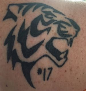 The tattoo on Brenda Hilton's shoulder - by former Richmond player Jake King.