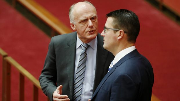 Eric Abetz and Zed Seselja in discussions in the Senate this week.