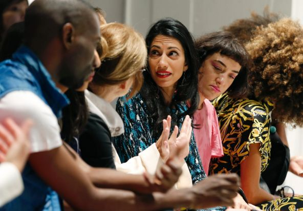 Huma Abedin, center, talks to friends before the start of the Prabal Gurung Spring/Summer 2018 fashion show.