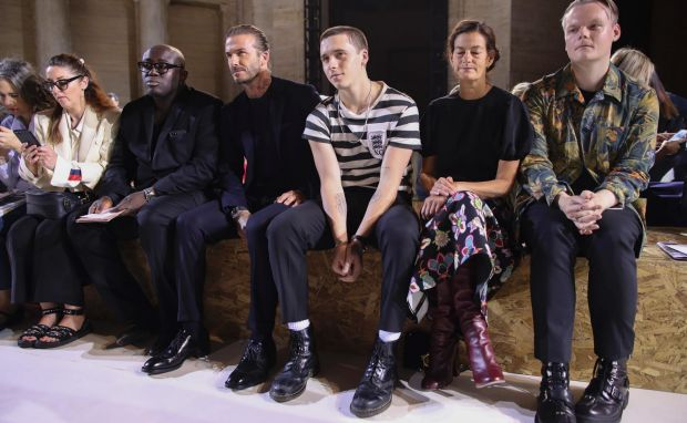 David Beckham, third from left, and Brooklyn Beckham, third from right, sit in the front row during the Victoria Beckham ...