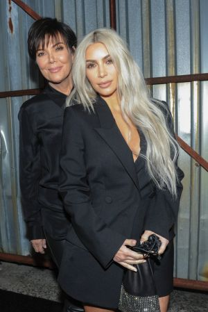 Kim Kardashian and Kris Jenner pose for a photo before the Alexander Wang Spring 2018 collection.