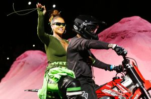 Rihanna rides on a motorcycle after showing her fashion collection from Fenty Puma by Rihanna.