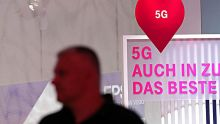 A 5G mobile data service sign sits on display at the Deutsche Telekom AG exhibition stand during the IFA Consumer ...