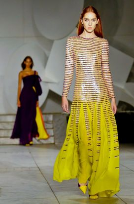 Fashion from Carolina Herrera collection is modeled.
