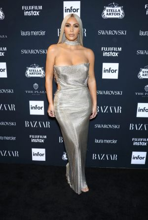 Kim Kardashian attends  The 2017 Harper's Icons in Versace.