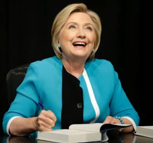 """Hillary Rodham Clinton signs copies of her book """"What Happened"""" at a book store in New York, Tuesday, Sept. 12, 2017. ..."""