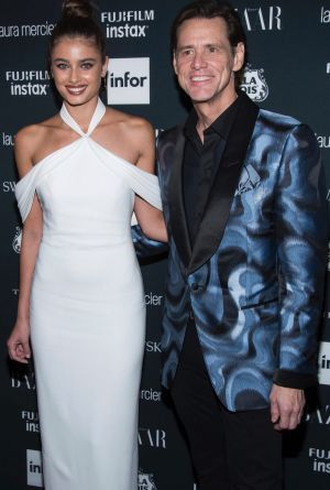 Taylor Hill and Jim Carrey attend the Harper's BAZAAR 'Icons by Carine Roitfeld' party.