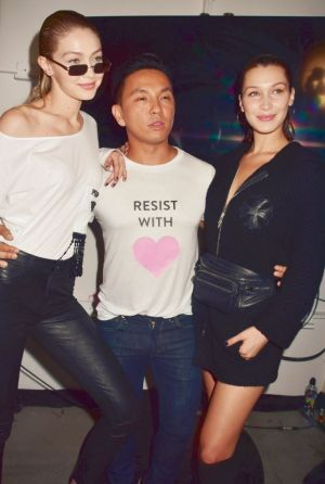 Bella Hadid and Gigi Hadid backstage with designer Prabal Gurung.