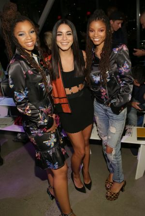 Vanessa Hudgens, center, and Chloe x Halle attend the Jeremy Scott 2018 Spring/Summer Presentation.