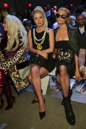 Nicky Hilton Rothschild, left, and Paris Hilton attend the Jeremy Scott 2018 Spring/Summer Presentation.