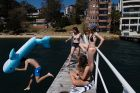 WEATHER Year 12 students take a day off school to enjoy Sydney's hot weather, Murray Rose pool, Double Bay 13th ...