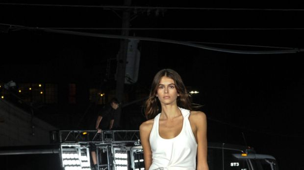 Kaia Gerber models the first look at the Alexander Wang Spring 2018 fashion show held on a street in the Bushwick ...