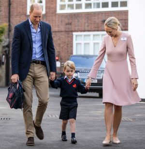 Britain's Prince William, left, accompanies Prince George and Helen Haslem - the head of the lower school on arrival for ...